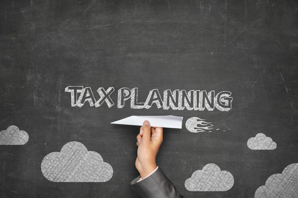 How to Invest Business Profits to Decrease Tax Obligations